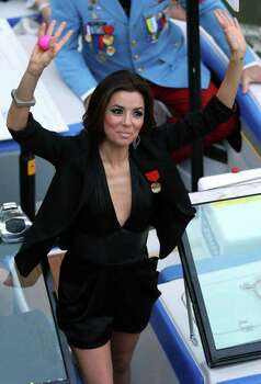 FOR METRO - Grand Marshal Eva Longoria waves to spectators during the Texas Cavaliers' River Parade Monday April 11, 2011. (PHOTO BY EDWARD A. ORNELAS/eaornelas@express-news.net) Photo: EDWARD A. ORNELAS / SAN ANTONIO EXPRESS-NEWS (NFS)