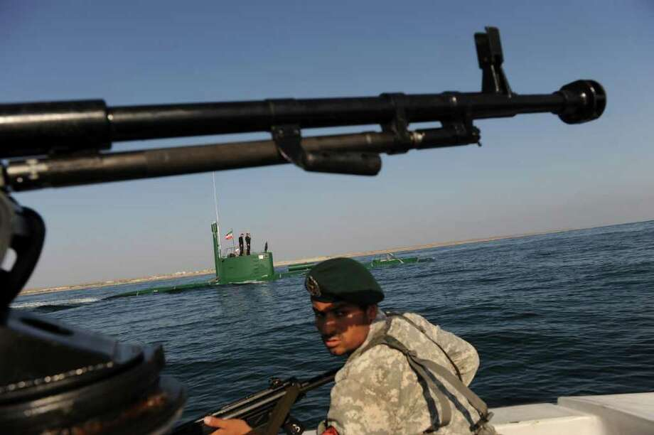 "The Iranian navy is drilling in international waters near the Strait of Hormuz. Rear Adm. Habibollah Sayyari has said closing it would be ""easier than drinking a glass of water."" Photo: ALI MOHAMMADI, INTERNATIONAL IRAN PHOTO AGENCY"