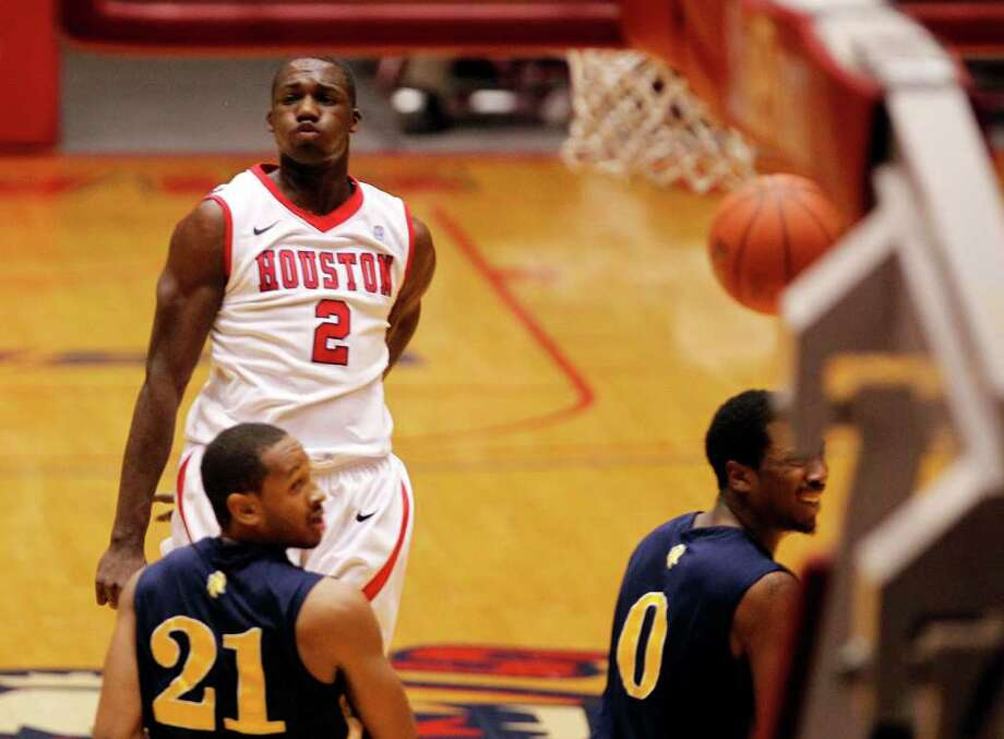 The University of Houston's Alandise Harris upper right reacts after shooting the ball against North Carolina A&T during first half of men's college basketball game action at the University of Houston's Hofheinz Pavilion Wednesday, Dec. 28, 2011, in Houston. Photo: James Nielsen, Chronicle / © 2011 Houston Chronicle