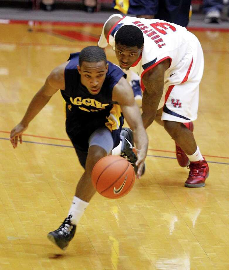 North Carolina A&T's Marc Hill left, breaks away from the University of Houston's J.J. Thompson during first half of men's college basketball game action at the University of Houston's Hofheinz Pavilion Wednesday, Dec. 28, 2011, in Houston. Photo: James Nielsen, Chronicle / © 2011 Houston Chronicle