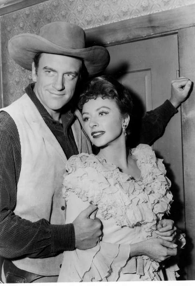 "TODAY IN HISTORY/SUN 09 10 00/GUNSMOKE - James Arness and Amanda Blake in ""Gunsmoke.""  The television show ""Gunsmoke"" premiered on CBS on September 10. 1955.  (PHOTO UNDATED) CREDIT: CBS SOURCE: EXPRESS-NEWS FILE PHOTO Photo: CBS / EXPRESS-NEWS FILE PHOTO"