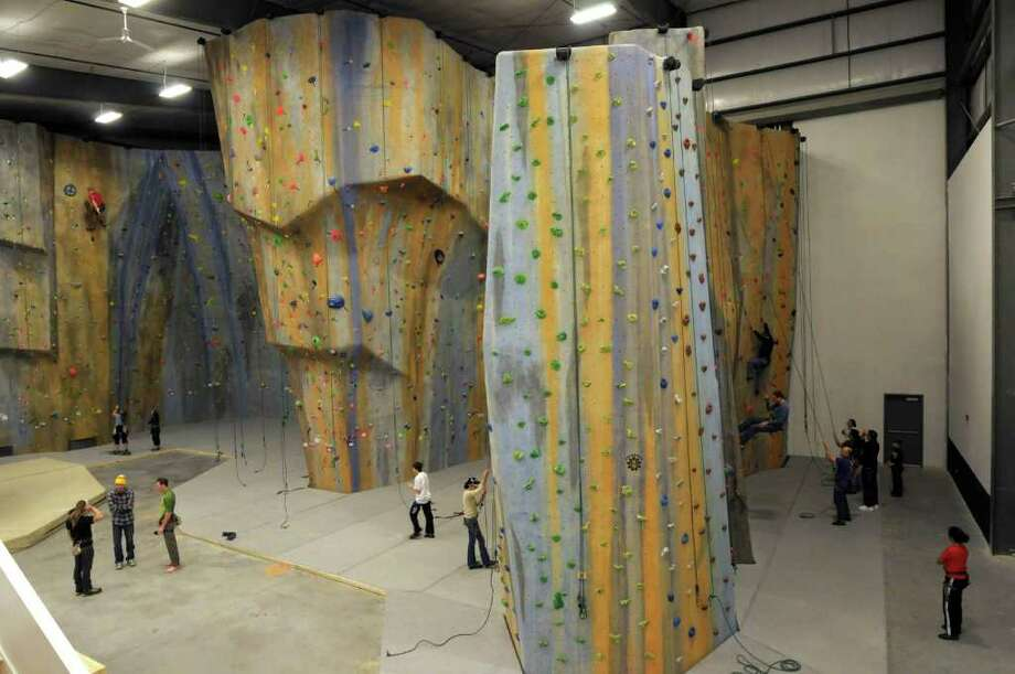 Climbers make their way up the walls at The Edge - Halfmoon rock climbing gym on Tuesday, Dec. 27, 2011 in Halfmoon, NY.  (Paul Buckowski / Times Union) Photo: Paul Buckowski / 00015910A