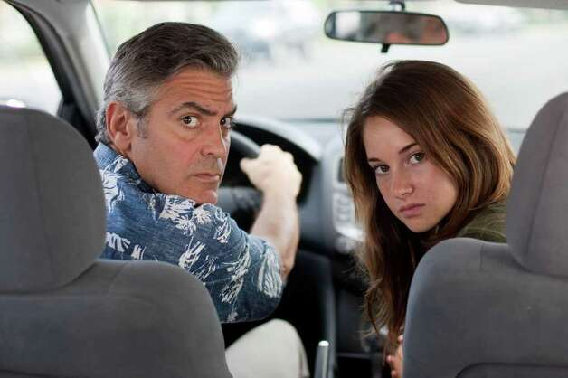 "In this image released by Fox Searchlight Films, George Clooney, left, and Shailene Woodley are shown in a scene from ""The Descendants."" The film was nominated, Wednesday, Dec. 15, 2011 for a Screen Actors Guild award for best ensemble cast. The 18th annual SAG Awards will be presented Jan. 29. Photo: AP"