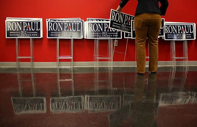 NEWTON, IA - DECEMBER 28:  A campaign worker sets up lawn signs for Republican presidential candidate U.S. Rep Ron Paul (R-TX) before a town hall meeting at the Iowa Speedway on December 28, 2011 in Newton, Iowa.  With less than one week to go before the Iowa caucuses, Ron Paul is trying to maintain his lead as he campaigns through Iowa.  (Photo by Justin Sullivan/Getty Images) Photo: Justin Sullivan, Getty