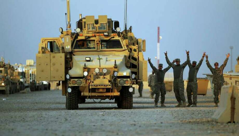 Scenes such as this of soldiers from the 1st Cavalry Division getting ready to leave Iraq are helping the military to reduce the number of slots it has for generals and admirals. Photo: MARIO TAMA, ASSOCIATED PRESS