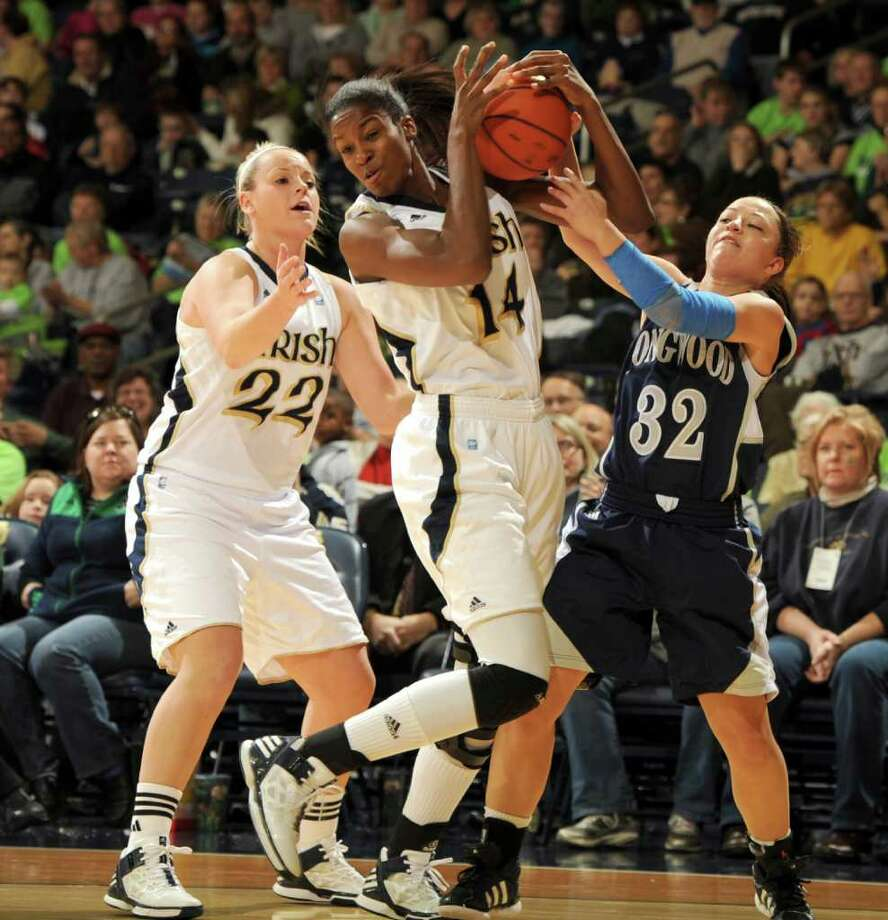 Notre Dame's Devereaux Peters wrestles the ball away from Longwood's Rianna Frazer. Photo: AP