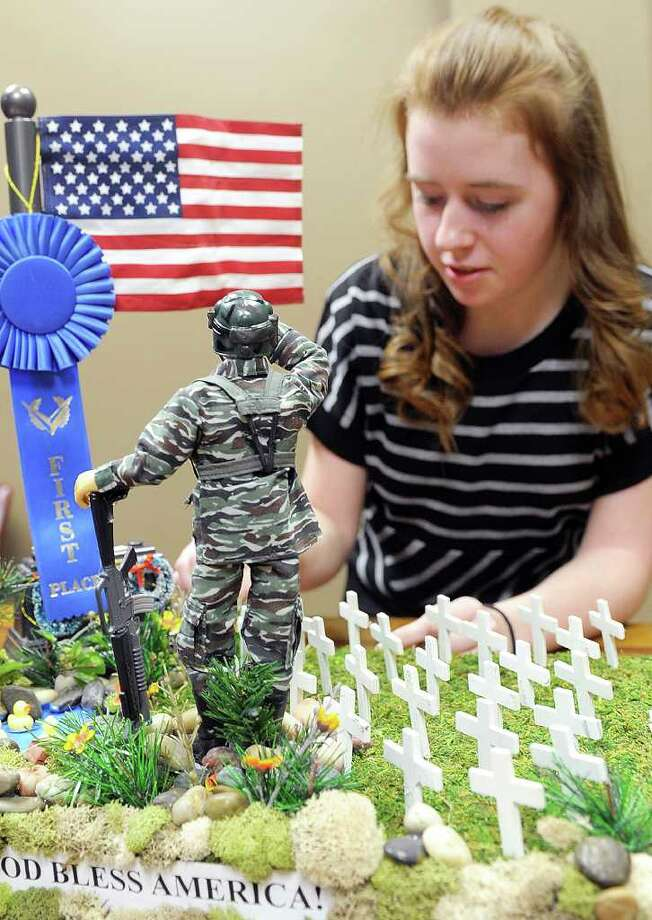 Savannah Hull, a ninth-grader, talks about a model of Fort Sill Cemetery that she created last year for an American history class project at Wichita Christian in Wichita Falls, Texas. She won first place for the model in a contest at her school and it was later displayed for six months at the visitor center at the actual cemetery near Lawton, Okla. The diorama was viewed by hundreds of visitors who left comments about the project in a notebook at the center. Photo: AP