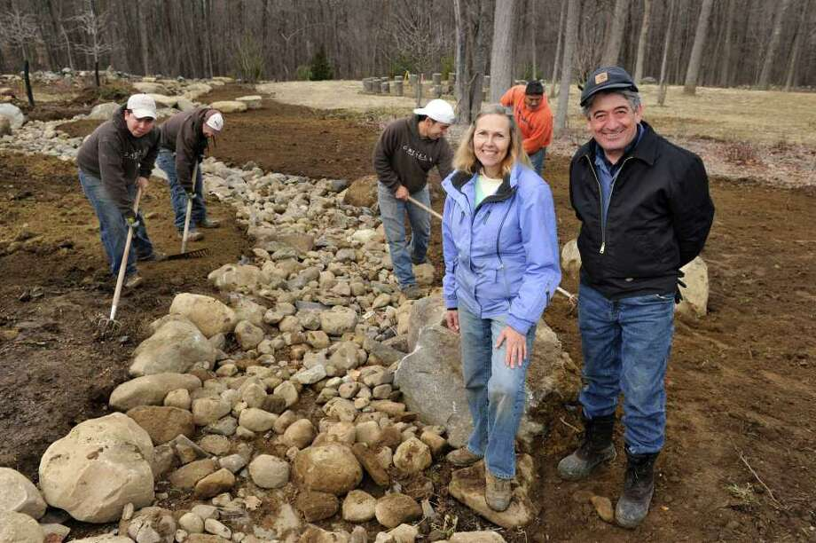 Camilla Worden, 57, of Brookfield, and John Petriello, 56, of Mt. Kisco, N.Y., are partners in Camilla Landscape Design, LLC. Photo: Carol Kaliff / The News-Times