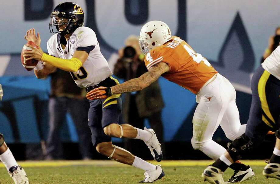 California quarterback Zach Maynard, left, is hauled down for a sack by Texas safety Kenny Vaccaro in the first half of the Holiday Bowl NCAA college football game, Wednesday, Dec. 28, 2011, in San Diego. (AP Photo/Gregory Bull) Photo: Gregory Bull, Associated Press / AP