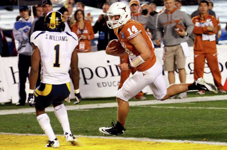Texas quarterback David Ash runs the ball into the end zone for a touchdown against California in the first half of the Holiday Bowl NCAA college football game, Wednesday, Dec. 28, 2011, in San Diego. (AP Photo/Lenny Ignelzi) Photo: Lenny Ignelzi, Associated Press / AP
