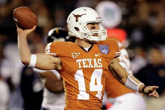 Texas quarterback David Ash throws a pass against California during the first half of the Holiday Bowl NCAA college football game, Wednesday, Dec. 28, 2011, in San Diego. (AP Photo/Gregory Bull)