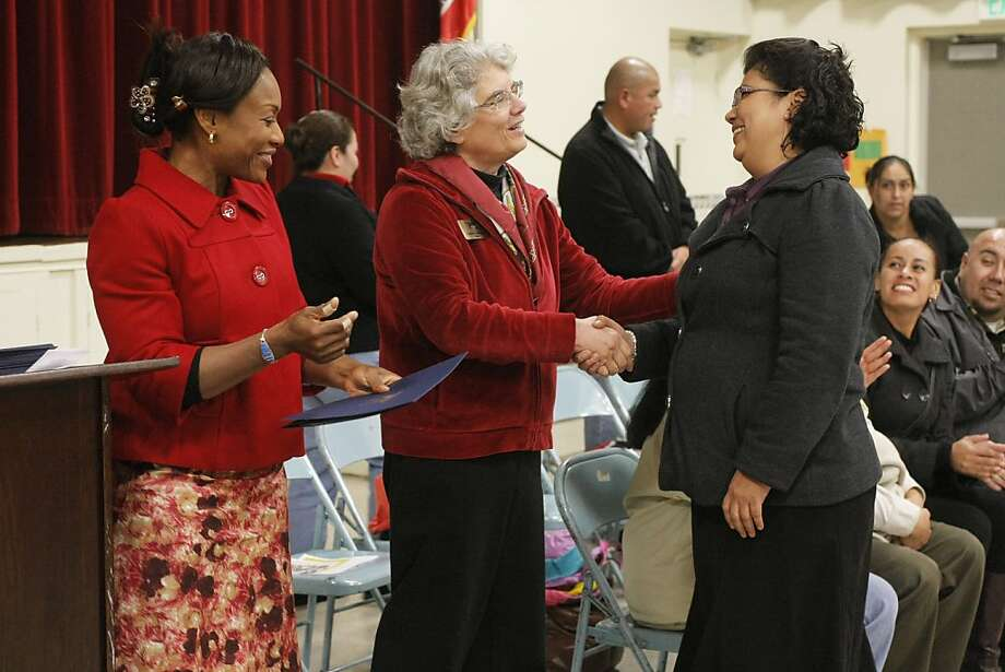 California PTA President Carol Kocivar (center) and Sunshine Gardens Elementary School Principal Ifeoma Obodozie (left) congratulate as she graduates from the School Smarts Parent Academy at Sunshine Gardens Elementary School in South San Francisco, Calif., on Thursday, Dec. 15, 2011. Photo: Dylan Entelis, The Chronicle