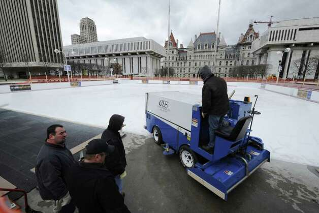 An OGS Zamboni machine wheels on to the ice on the Empire State Plaza this morning Dec. 28, 2011,  for maintenance in preparation for it's opening the timing of which is still to be determined according to OGS spokesperson Heather Groll.  ( Skip Dickstein/Times Union) Photo: Skip Dickstein