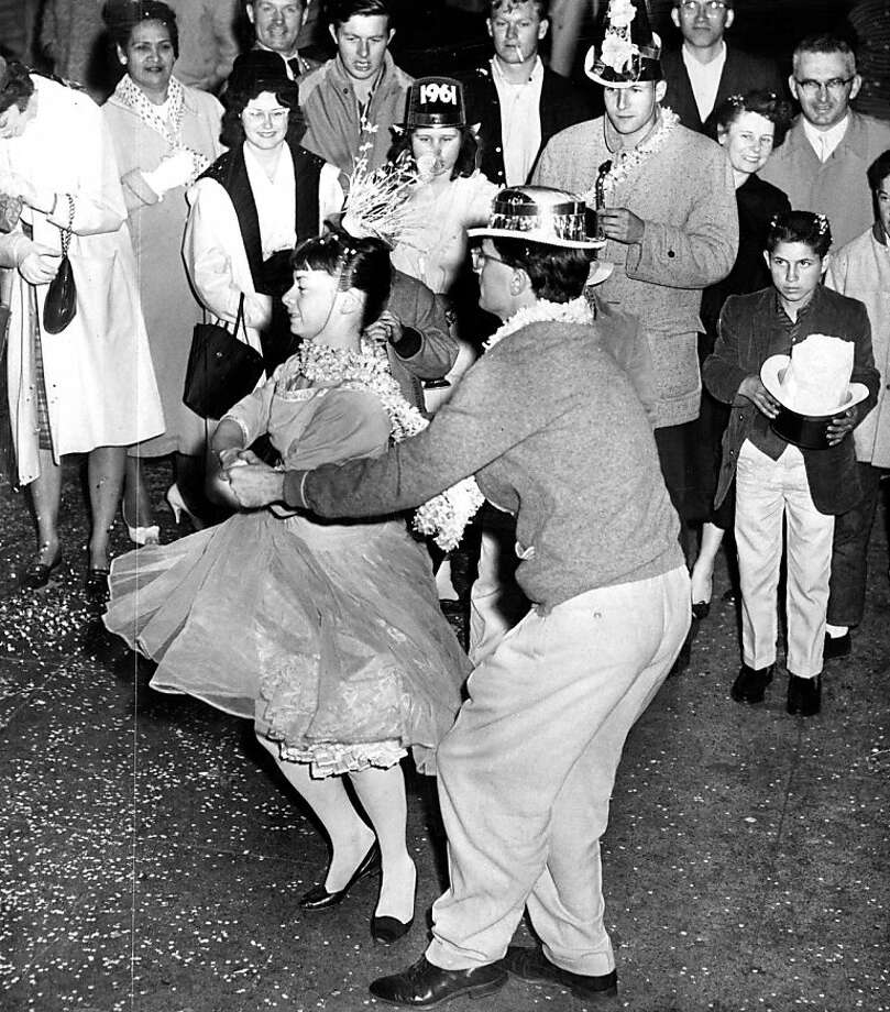 Will you be celebrating New Year's Eve like this San Francisco couple from 1960?Click ahead to see more historic photos of NYE in SF. Photo: Duke Downey, The Chronicle