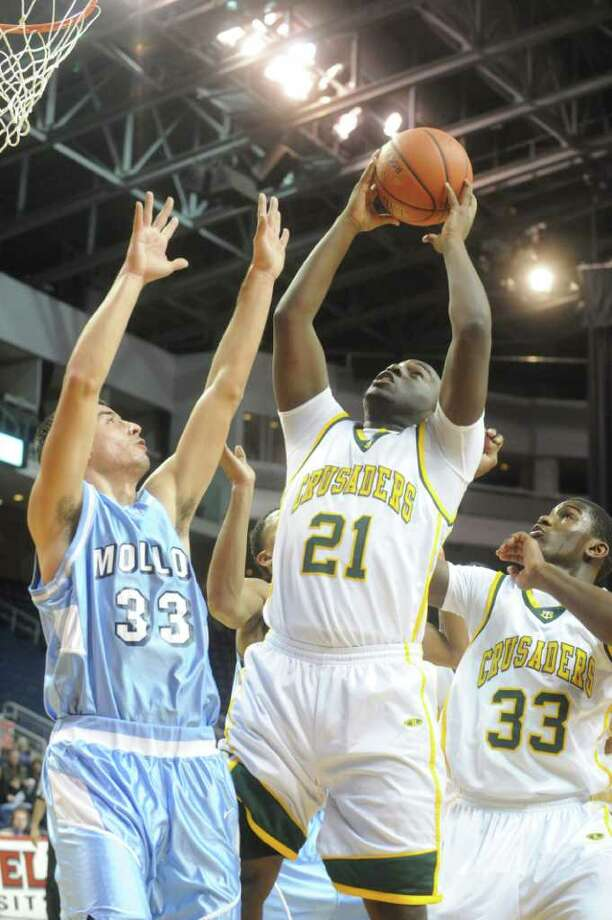 Trinity's Aaron Specnce in action as Trinity Catholic and Archbishop Molloy face off in the Northeast Basketball Christmas Classic at Harbor Yard's Webster Bank Arena in Bridgeport, Conn., December 28, 2011. Photo: Keelin Daly / Stamford Advocate