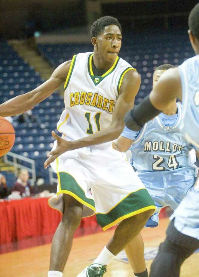 Trinity's Jason Boswell in action as Trinity Catholic and Archbishop Molloy face off in the Northeast Basketball Christmas Classic at Harbor Yard's Webster Bank Arena in Bridgeport, Conn., December 28, 2011. Photo: Keelin Daly / Stamford Advocate