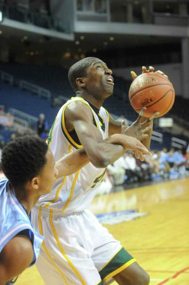 Trinity's Paschal Chukwu in action as Trinity Catholic and Archbishop Molloy face off in the Northeast Basketball Christmas Classic at Harbor Yard's Webster Bank Arena in Bridgeport, Conn., December 28, 2011. Photo: Keelin Daly / Stamford Advocate