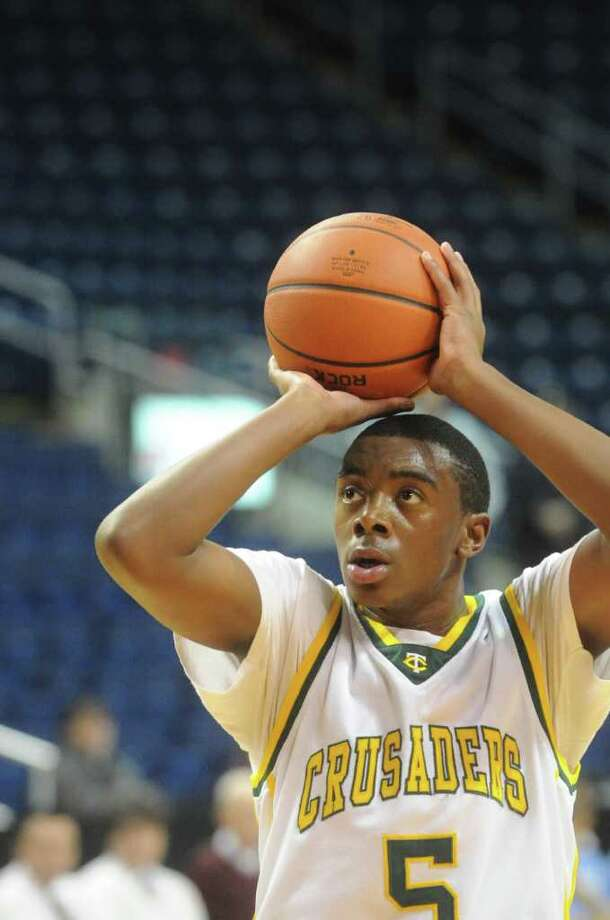 Trinity's Brandon Wheeler in action as Trinity Catholic and Archbishop Molloy face off in the Northeast Basketball Christmas Classic at Harbor Yard's Webster Bank Arena in Bridgeport, Conn., December 28, 2011. Photo: Keelin Daly / Stamford Advocate
