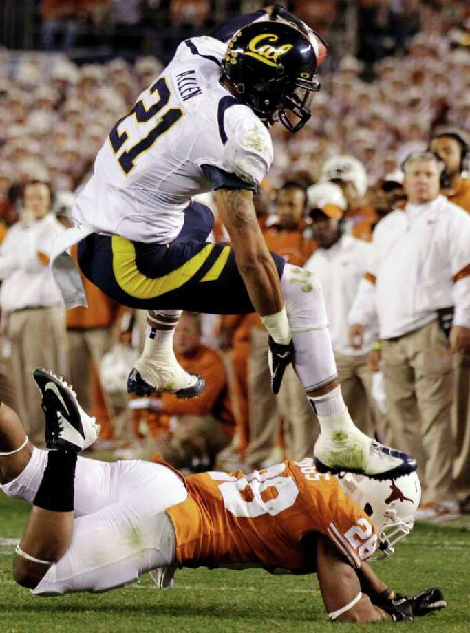 California wide receiver Keenan Allen hurdles Texas cornerback Quandre Diggs after catching a pass during the second half of the Holiday Bowl NCAA colege football game, Wednesday, Dec. 28, 2011, in San Diego. (AP Photo/Gregory Bull) Photo: Gregory Bull, Associated Press / AP