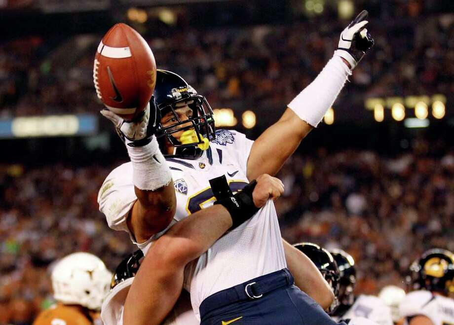 California running back Isi Sofele celebrates after his 6-yard touchdown run against Texas during the third quarter of the Holiday Bowl NCAA college football game, Wednesday, Dec. 28, 2011, in San Diego. (AP Photo/Lenny Ignelzi ) Photo: Lenny Ignelzi, Associated Press / AP