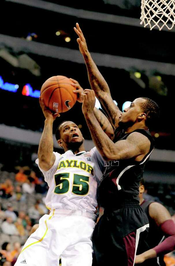 Pierre Jackson (left) saved Baylor with his game-winning basket against Mississippi State. Photo: AP