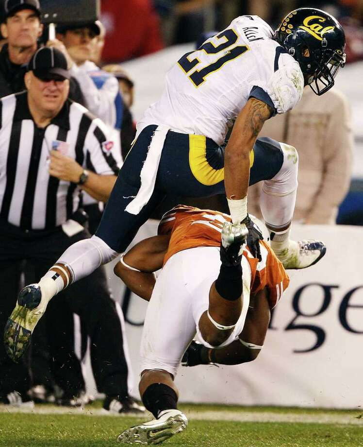 California wide receiver Keenan Allen hurdles Texas cornerback Quandre Diggs after catching a pass during the second half of the Holiday Bowl NCAA college football game, Wednesday, Dec. 28, 2011, in San Diego. (AP Photo/Lenny Ignelzi) Photo: Lenny Ignelzi, Associated Press / AP
