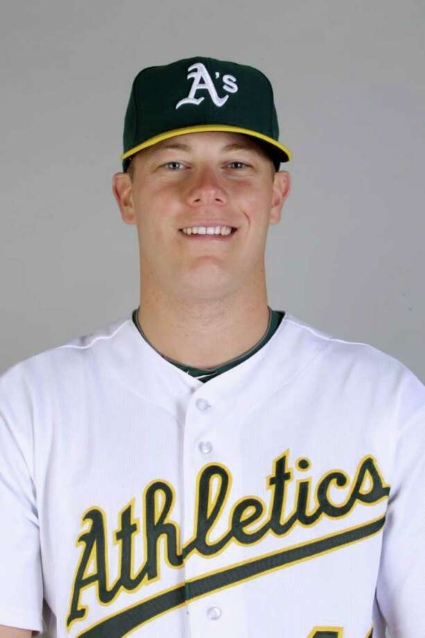 FILE - In this Feb. 24, 2011, file photo, Oakland Athletics' Andrew Bailey poses in uniform in Phoenix. A person with knowledge of the negotiations says the Oakland Athletics have agreed to trade All-Star closer Bailey and outfielder Ryan Sweeney to the Boston Red Sox for outfielder Josh Reddick and prospects Miles Head and Raul Alcantara. The person confirmed the deal, first reported by ESPN on Wednesday, Dec. 28, 2011, to The Associated Press on the condition of anonymity because final details are still being worked out before a formal announcement from the clubs. (AP Photo/Marcio Jose Sanchez) Photo: Marcio Jose Sanchez / AP2011