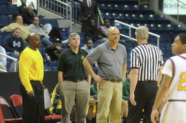 New London Coach Craig Parker speaks to a referee as St. Joseph and New London High Schools face off in the Northeast Basketball Christmas Classic at Harbor Yard's Webster Bank Arena in Bridgeport, Conn., December 28, 2011.  St. Joseph won 57-52. Photo: Keelin Daly / Stamford Advocate