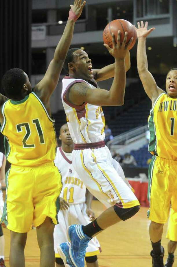 St. Joseph's Timajh Parker in action as St. Joseph and New London High Schools face off in the Northeast Basketball Christmas Classic at Harbor Yard's Webster Bank Arena in Bridgeport, Conn., December 28, 2011.  St. Joseph won 57-52. Photo: Keelin Daly / Stamford Advocate