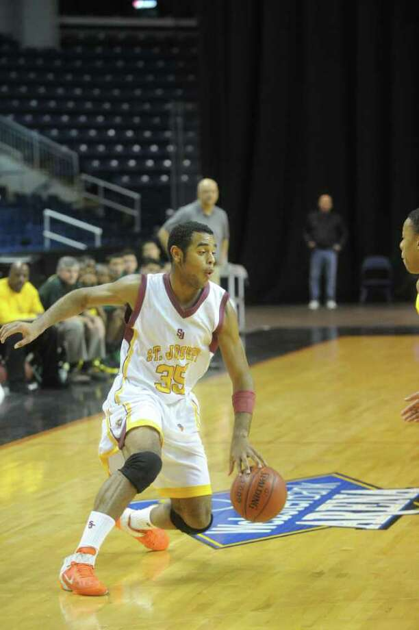 St. Joseph's Diamonte Zarba in action as St. Joseph and New London High Schools face off in the Northeast Basketball Christmas Classic at Harbor Yard's Webster Bank Arena in Bridgeport, Conn., December 28, 2011.  St. Joseph won 57-52. Photo: Keelin Daly / Stamford Advocate