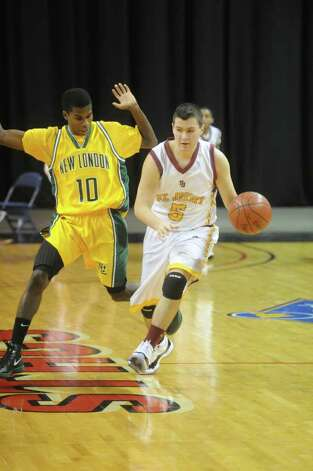 St. Joseph and New London High Schools face off in the Northeast Basketball Christmas Classic at Harbor Yard's Webster Bank Arena in Bridgeport, Conn., December 28, 2011.  St. Joseph won 57-52. Photo: Keelin Daly / Stamford Advocate