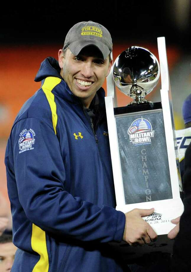 Toledo head coach Matt Campbell holds the trophy after the beat Air Force 42-41 in the Military Bowl college football game,Wednesday, Dec. 28, 2011, in Washington.  (AP Photo/Nick Wass) Photo: Nick Wass / FR67404 AP