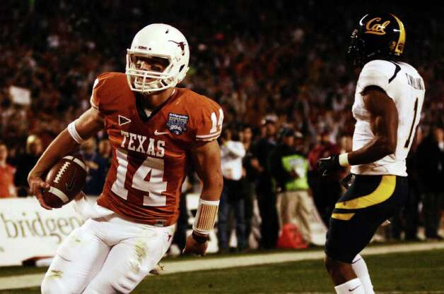 Texas quarterback David Ash finds the end zone during the second quarter of the Holiday Bowl NCAA college football game, Wednesday, Dec. 28, 2011, in San Diego. Texas won 21-10. Photo: AP