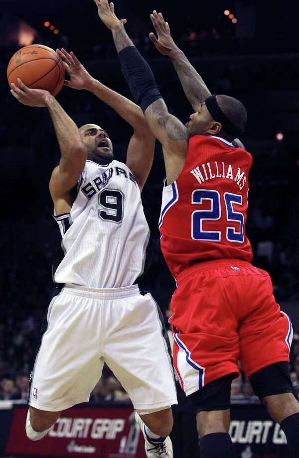 Tony Parker shoots over Mo Williams in the second half  as San Antonio plays the Los Angeles Clippers at the AT&T Center  on December 28, 2011 Tom Reel/Staff Photo: TOM REEL, Express-News / © 2011 San Antonio Express-News