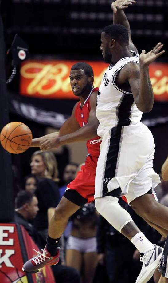 Clippers guard Chris Paul dishes back out from under the hoop as San Antonio plays the Los Angeles Clippers at the AT&T Center  on December 28, 2011 Tom Reel/Staff Photo: TOM REEL, Express-News / © 2011 San Antonio Express-News