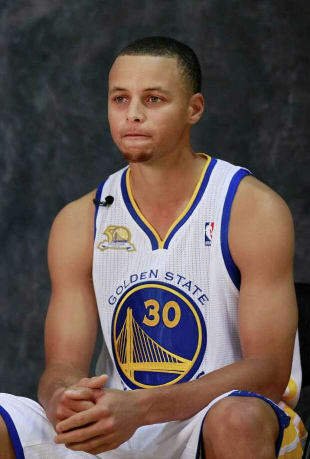 Golden State Warriors' Stephen Curry (30) poses for photographs at an NBA basketball training facility in Oakland, Calif., Monday, Dec. 12, 2011. (AP Photo/Jeff Chiu) Photo: Jeff Chiu / AP