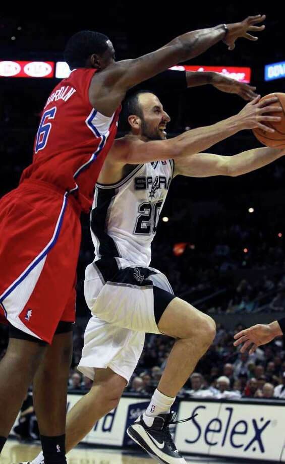 Manu Ginobili sneaks under DeAndre Jordan as San Antonio plays the Los Angeles Clippers at the AT&T Center  on December 28, 2011 Tom Reel/Staff Photo: TOM REEL, Express-News / © 2011 San Antonio Express-News