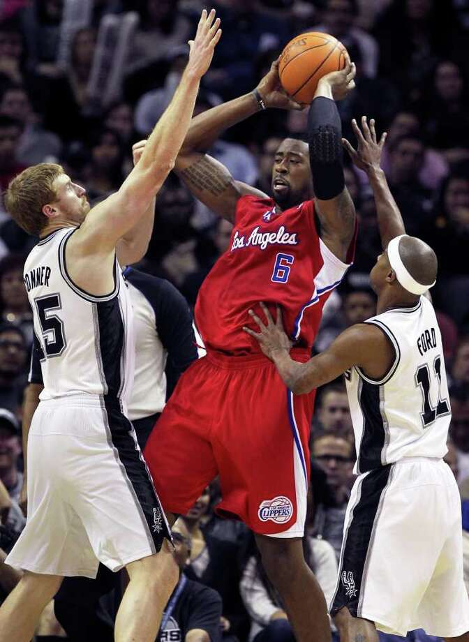 DeAndre Jordan is closely guarded by Matt Bonner and T.J. Ford as San Antonio plays the Los Angeles Clippers at the AT&T Center  on December 28, 2011 Tom Reel/Staff Photo: TOM REEL, Express-News / © 2011 San Antonio Express-News