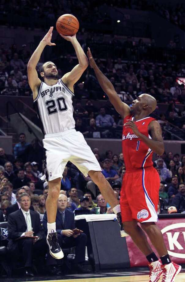 Manu Ginobili lofts up a three pointer over Chauncey Billups in the first half as San Antonio plays the Los Angeles Clippers at the AT&T Center  on December 28, 2011 Tom Reel/Staff Photo: TOM REEL, Express-News / © 2011 San Antonio Express-News