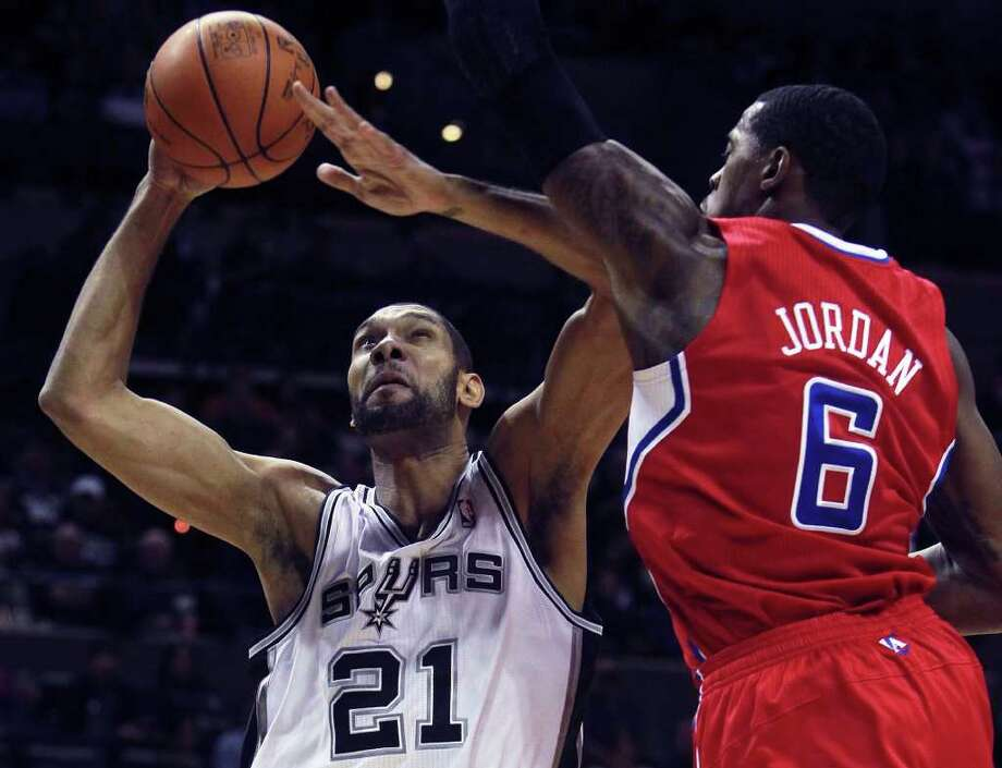 Tim Duncan goes up against DeAndre Jordan as San Antonio plays the Los Angeles Clippers at the AT&T Center  on December 28, 2011 Tom Reel/Staff Photo: TOM REEL, Express-News / © 2011 San Antonio Express-News