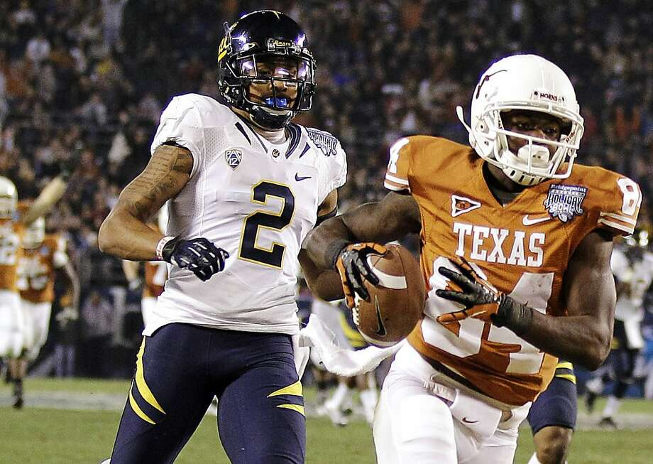 Texas wide receiver Marquise Goodwin (84) outruns California defensive back Marc Anthony (2) to the end zone while scoring on a 47-yard touchdown pass during the third quarter of the Holiday Bowl NCAA college football game, Wednesday, Dec. 28, 2011, in San Diego. (AP Photo/Gregory Bull) Photo: Gregory Bull, Associated Press