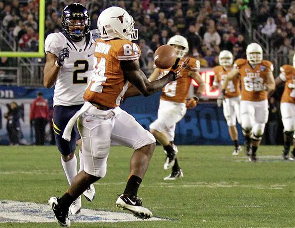 Texas wide receiver Marquise Goodwin pulls in a 46-yard touchdown pass against California during the third quarter of the Holiday Bowl NCAA college football game, Wednesday, Dec. 28, 2011, in San Diego. (AP Photo/Gregory Bull)