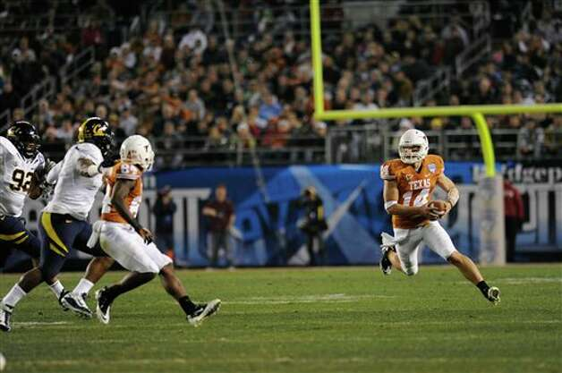 Texas quarterback David Ash (14) runs  during the second quarter of the Holiday Bowl NCAA college football game, Wednesday, Dec. 28, 2011, in San Diego. Texas won 21-10. (AP Photo/The Daily Texan, Elisabeth Dillion) Photo: Associated Press