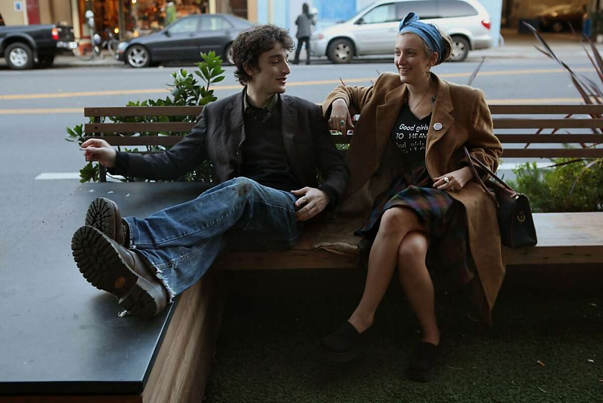 Zoe Roller from Brazil (right) and her brother Isaac Roller (left) from New York sit at the parklet in front of 914 Valencia St. in San Francisco, Calif., as they catch up while visiting home for the holidays on Wednesday, December 21, 2011.