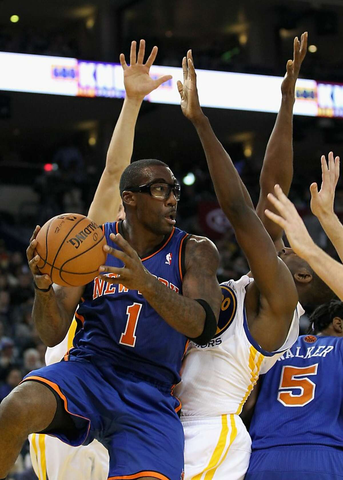 OAKLAND, CA - DECEMBER 28: Amare Stoudemire #1 of the New York Knicks looks to pass during their game against the Golden State Warriors at Oracle Arena on December 28, 2011 in Oakland, California. NOTE TO USER: User expressly acknowledges and agrees that, by downloading and or using this photograph, User is consenting to the terms and conditions of the Getty Images License Agreement. (Photo by Ezra Shaw/Getty Images)