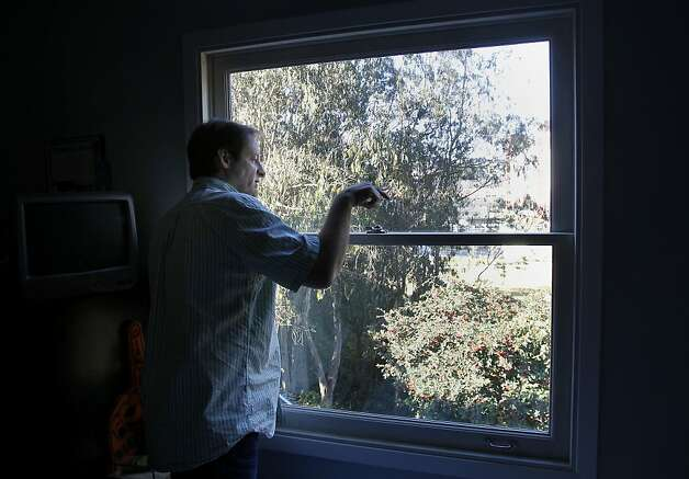 Terry Thompson looks out the window of his nephews room and complains about the noise and how it has scared the birds away. Terry Thompson and many of his neighbors are upset that the new Laguna Honda hospital in San Francisco, Calif. emits a loud hum, which he says is ruining the quality of life of the neighborhood. Photo: Brant Ward, The Chronicle