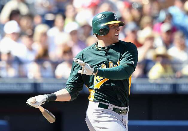 PEORIA, AZ - MARCH 12:  Ryan Sweeney #15 of the Oakland Athletics bats against the Seattle Mariners during the spring training game at Peoria Stadium on March 12, 2011 in Peoria, Arizona.  (Photo by Christian Petersen/Getty Images) Photo: Christian Petersen, Getty Images