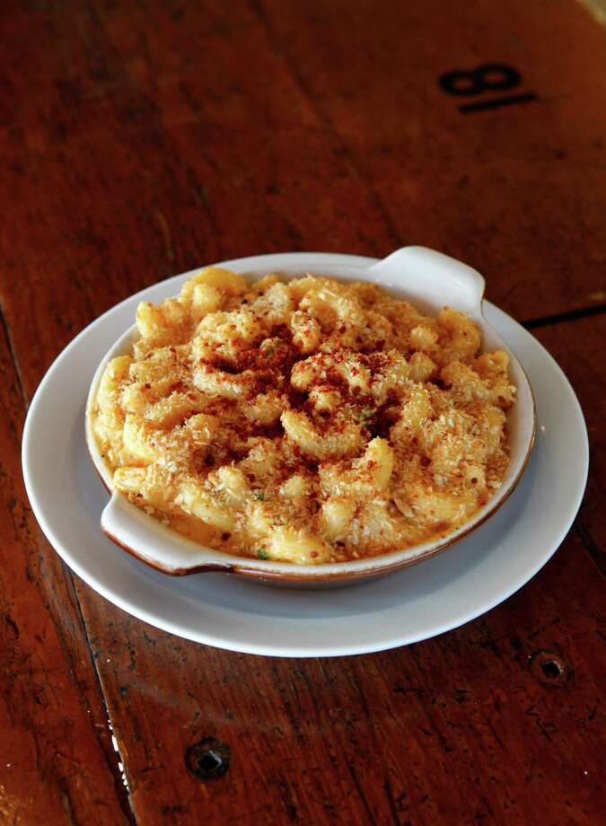 Homeroom: Mac and cheese, America's favorite side dish, moves to the center of the plate at this restaurant on the outskirts of Oakland's Temescal district. Indulge in a dozen versions including classic ($8.50), smoky bacon mac ($9.95) or the Trailer Mac ($9.95) with Niman Ranch hot dog and crushed potato chips. Not decadent enough? There's a list of add-ons such as chorizo and a fried egg. Virtuous sides include spicy roasted cauliflower ($4.50), roasted Brussels sprouts ($5.50) and minty peas ($3.75).Vitals: 400 40th St. (near Shafter Avenue), Oakland; (510) 597-0400. www.homeroom510.com. Lunch or brunch and dinner Tuesday-Sunday. Photo: Beck Diefenbach / Special To The Chronicle / ONLINE_YES