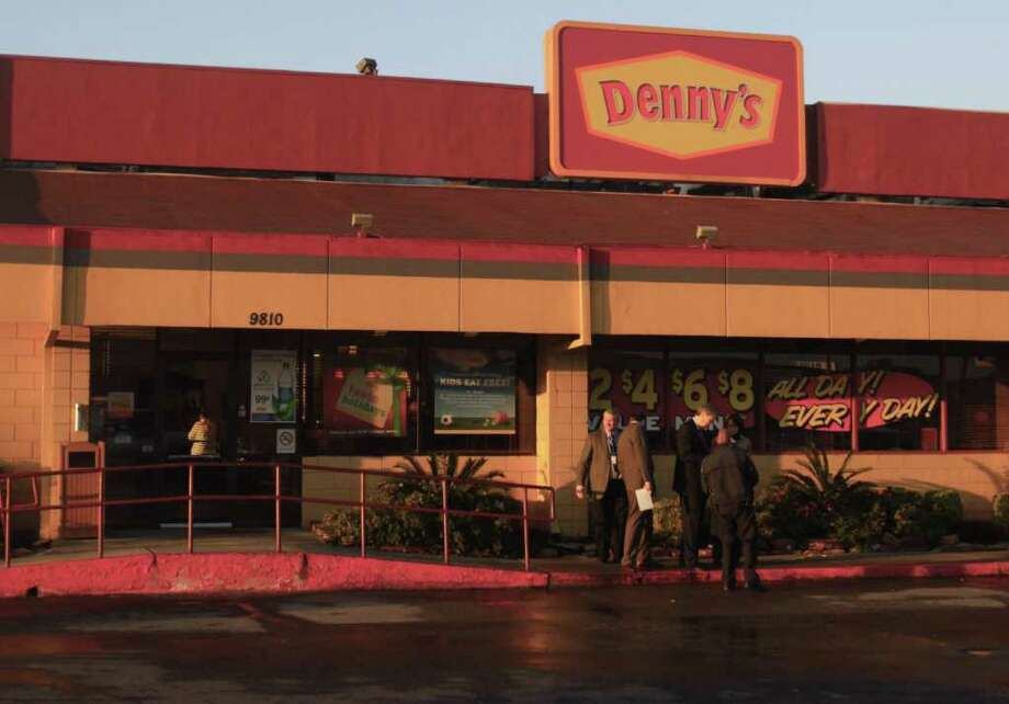 Authorities investigate the scene of an officer-involved shooting at a Denny's in the 9800 block of Gulf Freeway on Thursday, Dec. 29, 2011 in Houston. Photo: Cody Duty