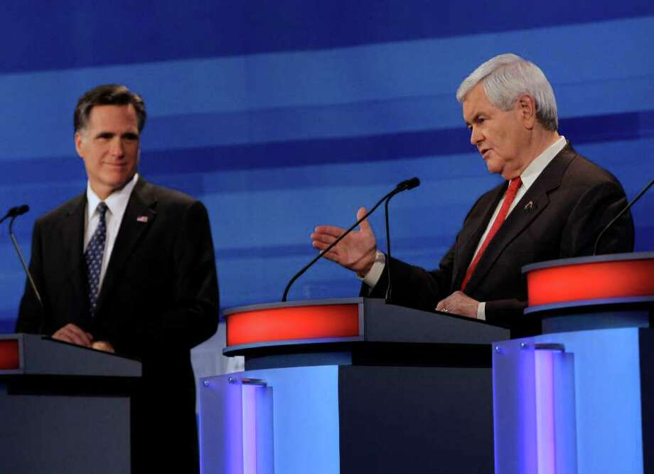 Mitt Romney (left)  and Newt Gingrich debate. The columnist's brother says Romney (a former governor and a businessman) can help fix the economic mess. Gingrich, he says, is too volatile with too much baggage. Photo: Associated Press, Eric Gay